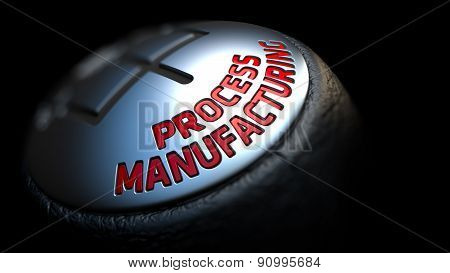 Process Manufacturing on Gear Stick with Red Text.