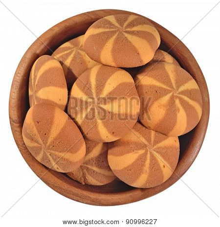Sweet Round Cookies In A Wooden Bowl On A White