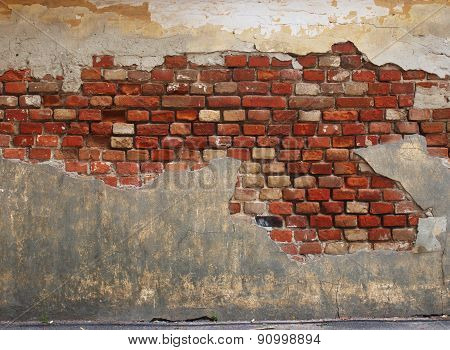 Stone Wall Of The Old Brick And Plaster