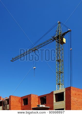 Multistory Building Under Construction With Crane