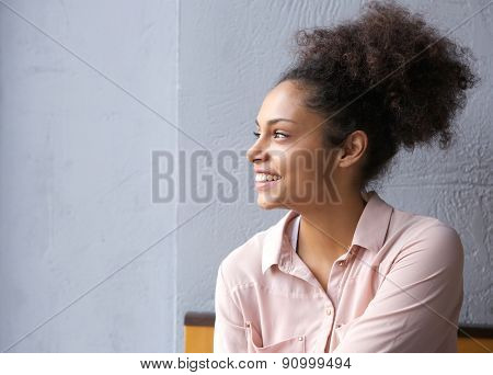 African American Woman Smiling And Looking Away