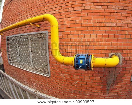 Wall Of A Building With A Gas Pipe And A Large Valve