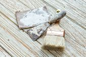 foto of trowel  - paintbrush trowel sandpaper still life wood teak table antique white old style - JPG