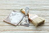 image of trowel  - paintbrush trowel sandpaper still life wood teak table antique white old style - JPG