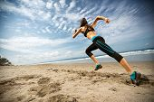 Running woman, female runner jogging during outdoor workout on beach., fitness model outdoors. poster