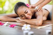 picture of thai massage  - professional masseur doing massage of female back in the beauty salon - JPG