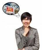 Multiethnic Woman With Thought Bubbles Of Sold Real Estate Sign