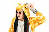 stock photo of greenpeace  - Rock musician in a costume of giraffe dancing and singing at studio - JPG