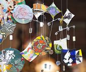picture of chimes  - Colorful glass wind chime hanging outside - JPG