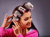stock photo of hair curlers  - Happy woman wear hair curlers on head - JPG