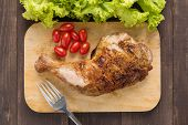 foto of thighs  - Marinated grilled chicken thigh BBQ on a wooden board - JPG