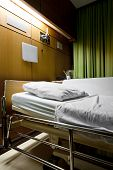foto of ward  - Clean empty sickbed in a hospital ward at night - JPG