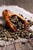 picture of peppercorns  - Green peppercorns in wooden scoop on burlap - JPG