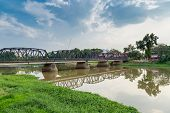 stock photo of old bridge  - Old bridge traditional ping river in chiang mai - JPG