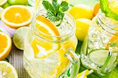 image of infusion  - Infused water with fresh citrus fruits and ice - JPG
