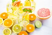 stock photo of infusion  - Infused water with fresh citrus fruits and ice - JPG
