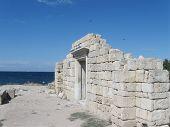 picture of sevastopol  - Ancient city Chersonesos Tauric,wall of famous Basilica  1935 (VI-X c.) - symbol of Chersonese,  view Black sea and blue sky  in background, Sevastopol, Peninsula of Crimea, Russia. - JPG