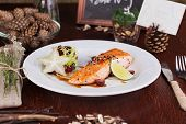 picture of sesame seed  - food salmon with sesame seeds on a plate in a still life with anise and salad Fries - JPG
