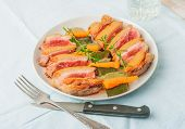 image of duck breast  - baked duck breast with zucchini and carrots on white plate - JPG