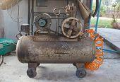 stock photo of air pressure gauge  - Rusty air compressor (belt drive), part of air compressor. ** Note: Shallow depth of field - JPG