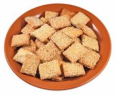 image of sesame seed  - Cookies with sesame seeds on a ceramic plate on a white background - JPG