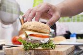 stock photo of hamburger  - Chef cooking and decorated Hamburger  - JPG