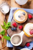 image of curd  - Cup of coffee and delicious homemade tartlets served with lemon - JPG