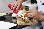 pic of hamburger  - Chef putting Tomato sauce to Hamburger  - JPG