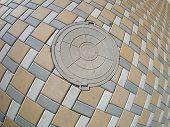 foto of manhole  - Manhole on the pavement with wide angle fisheye view - JPG