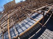 stock photo of reinforcing  - Urban construction site with metal reinforcement focus on foreground with wide angle fisheye view - JPG
