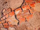 picture of fragmentation  - Fragment of an old shabby brick wall with wide angle fisheye lens view - JPG