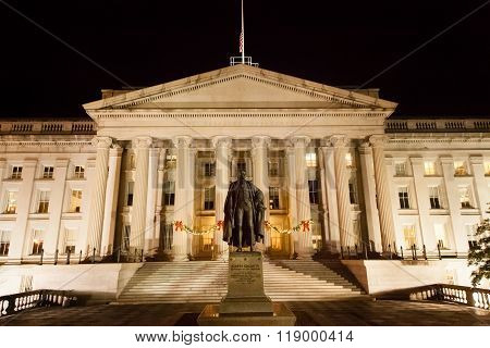 Washington DC - December 5 2015: A view of the Treasury Department building at night decorated for Christmas