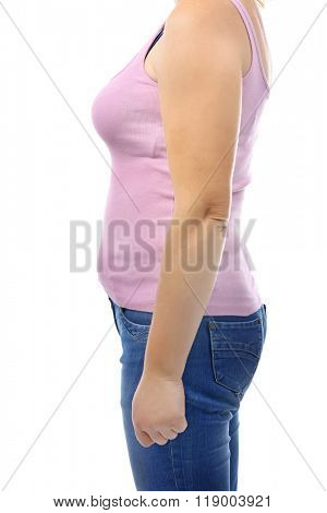 Chubby woman's body in pink shirt and jeans isolated on white