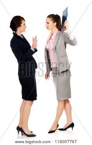 Businesswoman disagree with her friend idea.