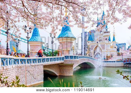 Lotte World amusement park and cherry blossom of Spring.