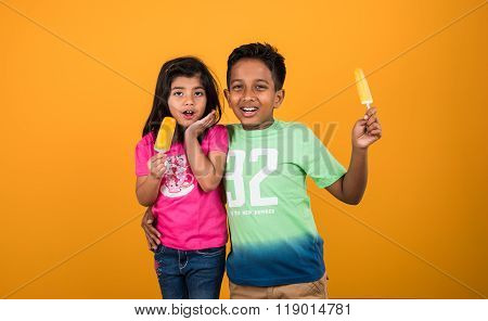 indian girl and boy and ice cream or ice candy, indian kids eating ice cream, asian kids and ice cre