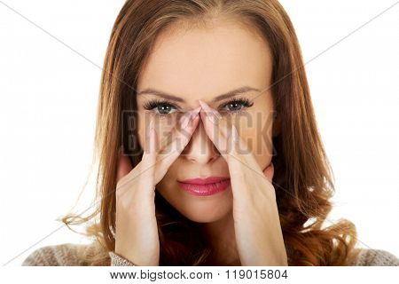 Woman with sinus pressure pain.