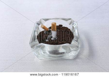 Ashtray On The White Table.