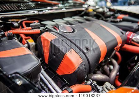 Red And Black Engine Of A Modern Car