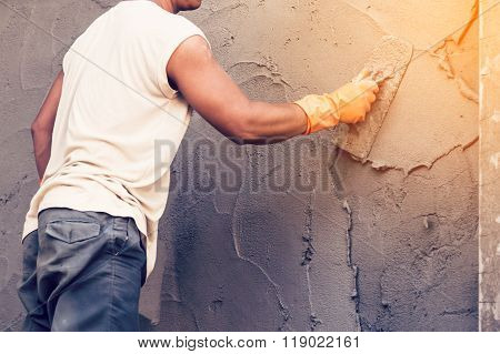 Man Plasterer Concrete Working At Wall Of Home Construction Building.