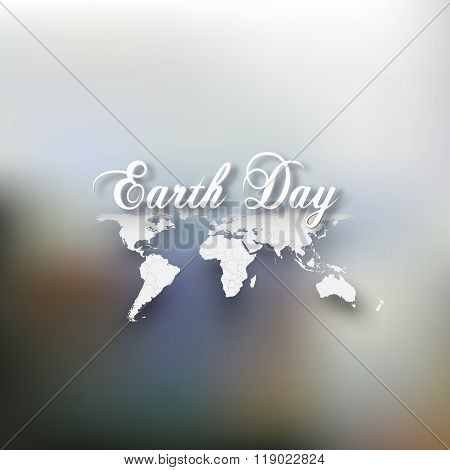 Earth Day. Greeting card with the words, world map on blurrred background. Vector illustration