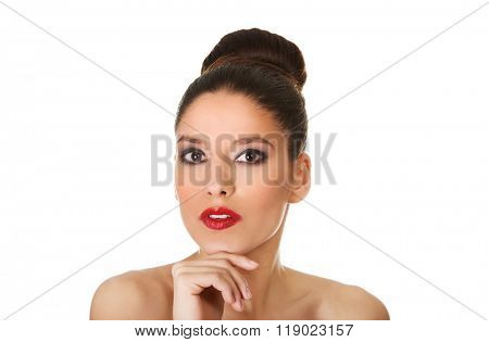 Beautiful topless woman with make up.