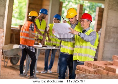Architect and investiture of construction consider possibilities at  construction site