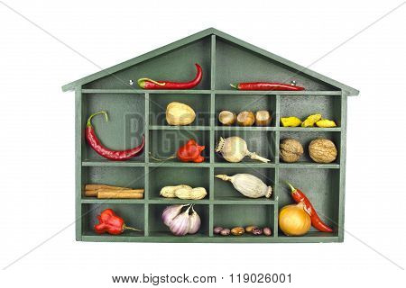 Shelf With A Roof Filled With Various Vegetable, Nuts And Spices