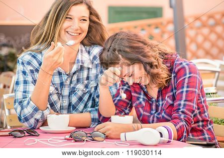 Happy Couple Of Women Girlfriends Drinking Cappuccino And Laughing Together - Happiness Concept