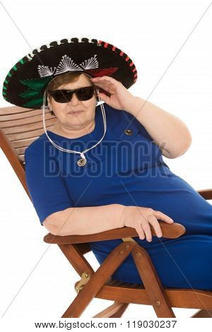 An elderly woman with glasses and a sombrero