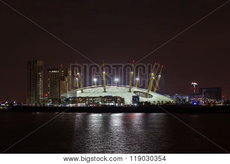 LONDON UK - 16TH JULY 2015: The Millenium Dome in London from across the River Thames. New apartments can be seen at the side.