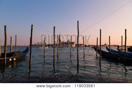 VENICE ITALY 13TH MARCH 2015: The Church of San Giorgio Maggiore from the main Venice waterfront showing wooden posts in the foreground