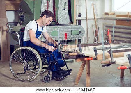 Worker In Wheelchair In A Carpenter's Workshop