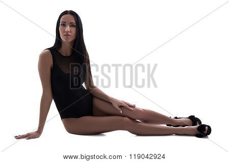 Beautiful Slim Sexy Woman In Black Lingerie Sitting Isolated On White